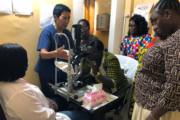 Dr. Ross teaching on the slit lamp in Liberia during her stay with the Fulbright program.