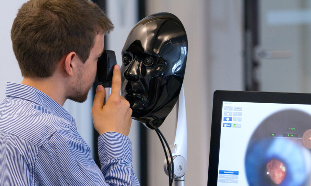 Student examining a virtual patient on the Eyesi Direct Ophthalmoscope simulator.